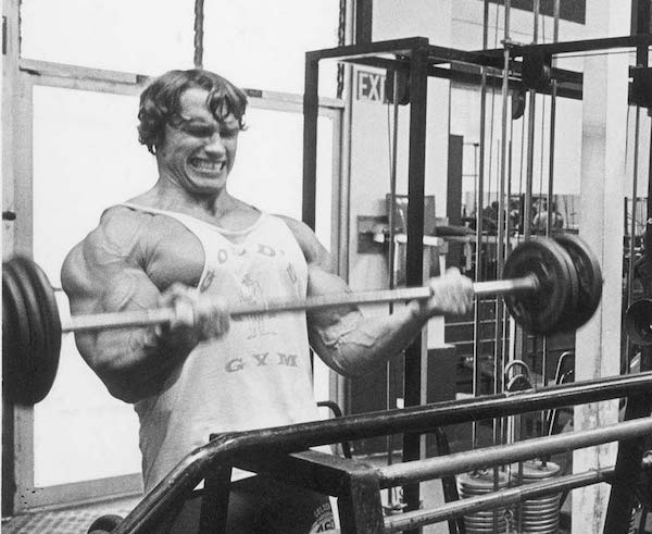 Arnold working the biceps