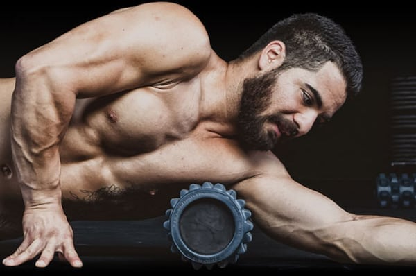 Bodybuilder Using Foam Roller